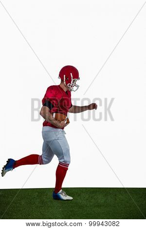 American football player running with football on american football field