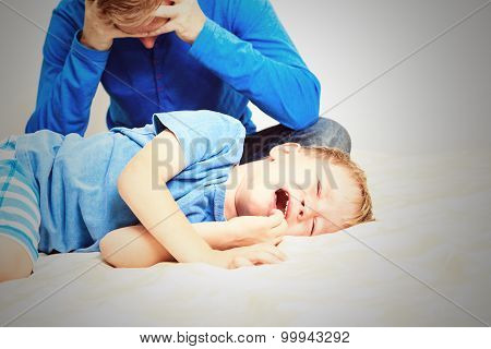 crying child, tired father