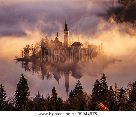 Lake Bled church on the island covered in mist