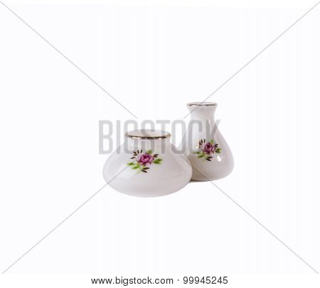 Two white porcelain flower vase with floral ornament isolated on white background