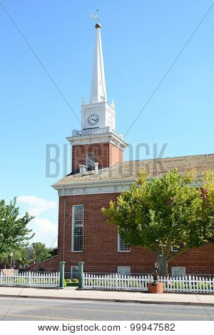 St. George Tabernacle in St. George, Utah was opened in 1876, with a dedication featuring Brigham Young, Jr. It was to serve as a public works building, hosting church services and court hearings.