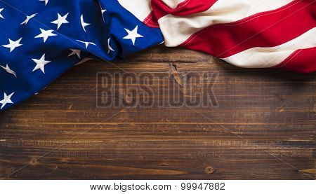 An old american flag on a antique wooden platform with copy space