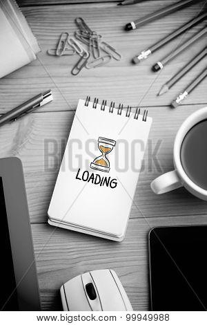 loading doodle against notepad on desk