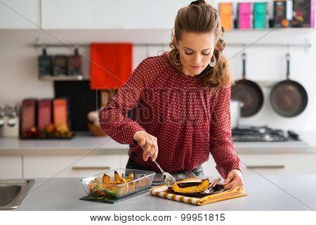 Elegant Woman Serving Pumpkin In Modern Kitchen