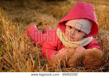 The Girl With A Soft Toy Near Haystacks
