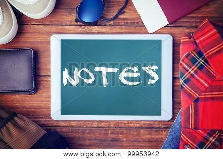 The word notes and differents objects using every days against teal, blue