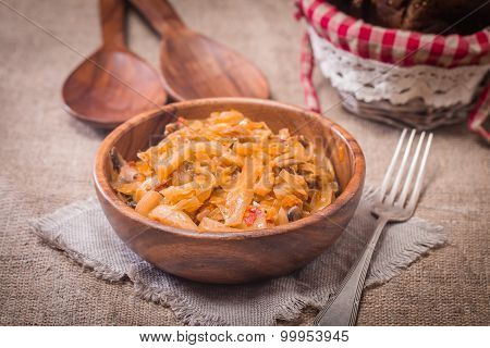 Cabbage Stewed  In Portions Wooden Plate