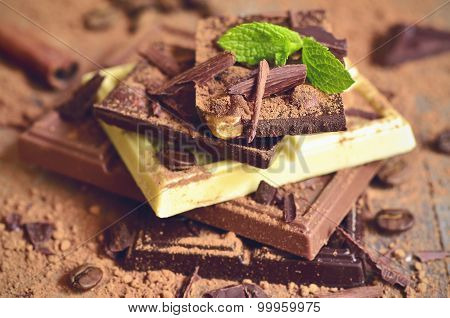 Stack Of Chocolate Slices With Cacao Powder.