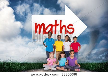 The word maths and elementary pupils smiling against road leading out to the horizon
