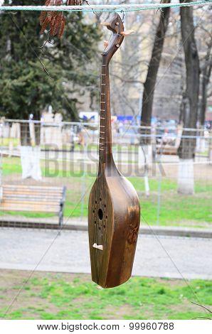 Dombra - stringed musical instrument. Flea market in Tbilisi. Georgia