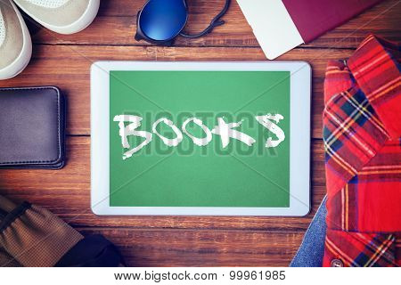 The word books and differents objects using every days against green