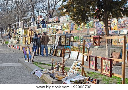 Tbilisi, Georgia - March,2 2015:Paintings rows on Flea market in Tbilisi, Georgia