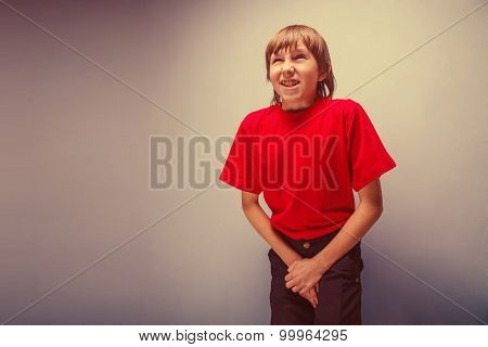 Boy, teenager, twelve years in the red shirt wants to use  toile