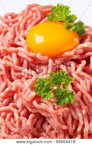 close up of raw minced meat with egg yolk