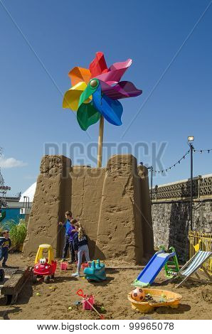 Children And Giant Sandcastle