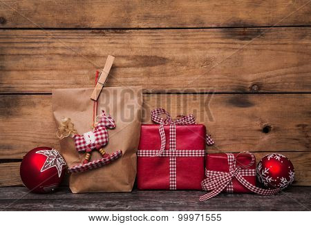 Old wooden background for christmas with red white checked gift boxes.