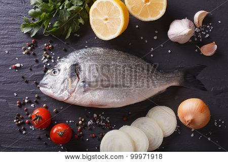Raw Fish Dorado With The Ingredients On The Table. Horizontal Top View
