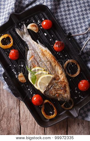 The Process Of Preparing Grilled Dorado Fish On The Grill. Vertical Top View