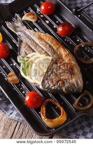Dorado Fish With Vegetables Closeup On The Grill Pan. Vertical