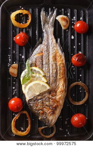 Dorado Fish With Vegetables Closeup On The Grill. Vertical Top View