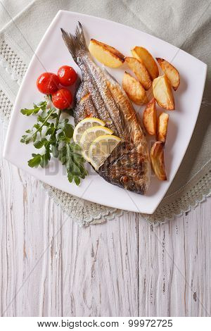 Grilled Dorado Fish With Fried Potatoes And Tomato. Vertical Top View
