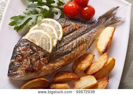 Grilled Dorado Fish With Potatoes Closeup. Horizontal Top View