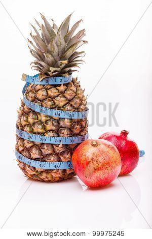 Pineapple Pomegranate And Measuring Tape