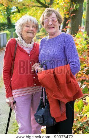 Happy Senior Ladies In Autumn Clothing.