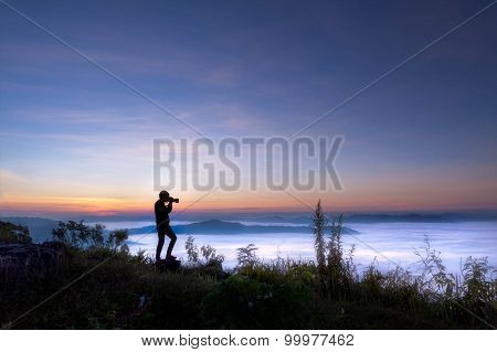 Silhouette Of Photographer Taking Picture On Landscape At Doi Phatang Chiang Rai, Thailand