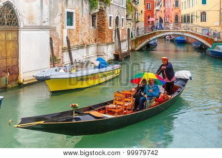 Gondola on canal in rainy day, Venice, Italy