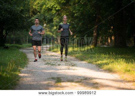 Healthy Fitness Couple Jogging Outdoors