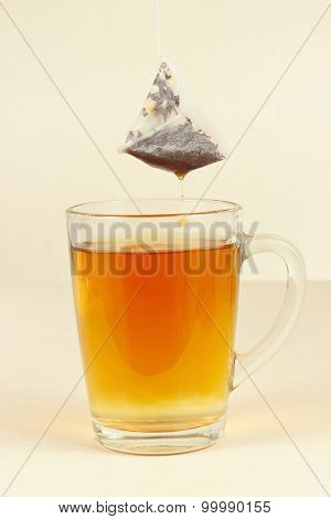 Tea bags over glass with brewed tea