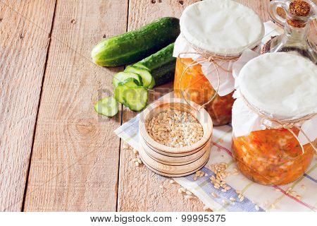Preserves Pearl Barley, Cucumber, Pickle In The Bank On A Wooden Background, Place For Text