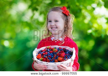 Little Girl With Fresh Berries In A Basket