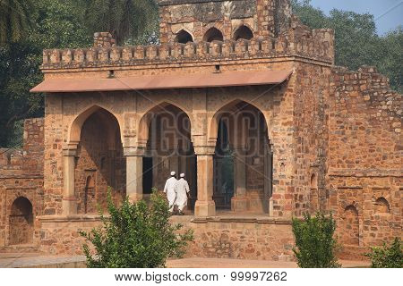 Delhi, India - November 4: Unidentified Men Walk Around Isa Khan Tomb At Humayun's Tomb Complex On N