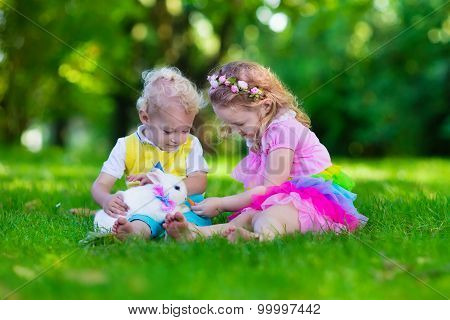Kids Playing With Pet Rabbit