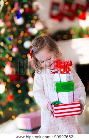 Little Girl Opening Presents On Christmas Morning