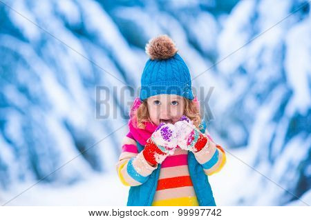 Little Girl Playing In Snowy Winter Forest