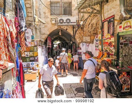 Jerusalem, Israel - July 13, 2015: Narrow Stone Street Among Stalls With Traditional Souvenirs And G