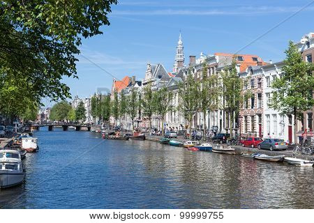 Canal In Amsterdam With Historic Mansions