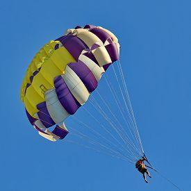 image of parasailing  - Parasailing in a blue sky near sea beach  - JPG