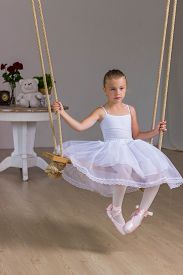 stock photo of fairy tail  - Portrait of little cute ballerina on swing - JPG