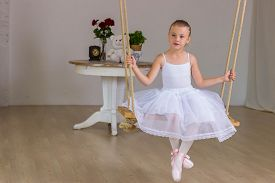 foto of fairy tail  - Portrait of little cute ballerina on swing - JPG